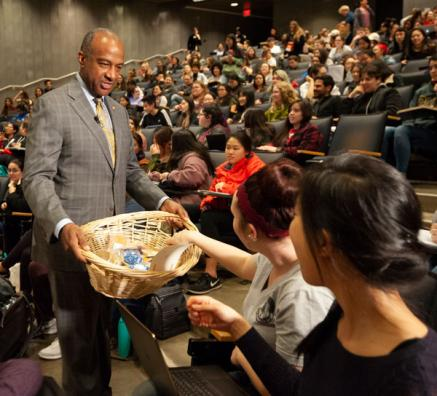 Chancellor May passes out cookies at teaching prize celebration.