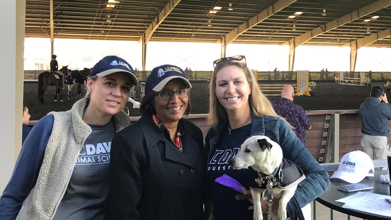 Assistant Dean Christine Schmidt, Dean Helene Dillard, Amy McLean and Marshmallow at the UCD Equestrian meet